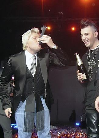 ...а потом выпил из неё шампанского.