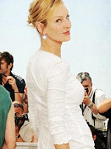 В день открытия Каннского кинофестиваля Ума показала себя во всей красе, нарядившись в облегающее платье от Дольче и Габбана. Фото Daily Mail.