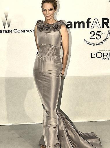Ума Турман - одна из главных звёзд Канн. На этот раз актриса выбрала серое платье, украшенное розами. Фото Splash/All Over Press.