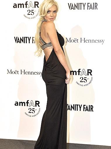 Скандальную старлетку Линдси Лохан на Миланской неделе моды было не узнать. Фото REUTERS.