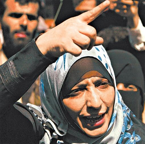 Таваккул Карман из Йемена отстаивает права женщин-журналистов.