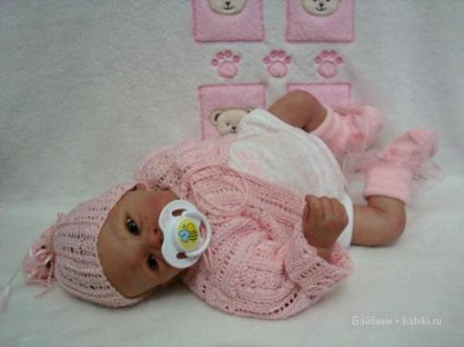 Очаровательная малышка... Фото с сайта babiki.ru