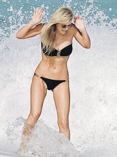 А Юлия Воронина на пляже Майами - с мужем Андреем.