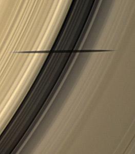 Астрономы уверяют, что тень отбросил Мимас - спутник Сатурна.