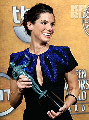 Гильдия вручила Сандре Баллок статуэтку как лучшей актрисе минувшего года. Фото: АП.