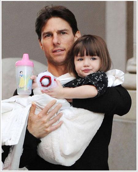 Круз дочку на руках носит, так он ее любит. Фото: Wenn.com