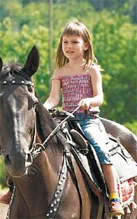 Дети обожают прогулки на лошадях!