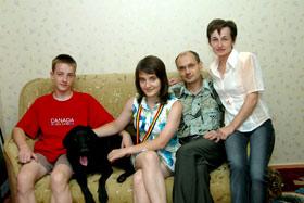 Катя обожает свою семью.