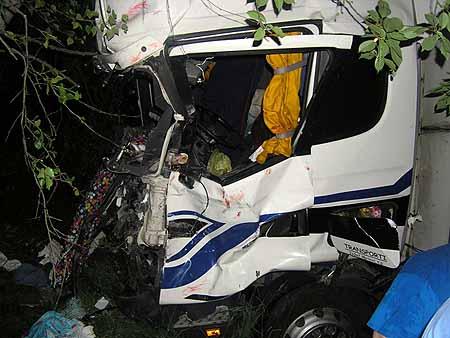 Фуру смяло в гармошку, но водитель выжил.