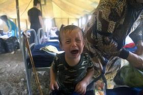 Лагерь грузинских беженцев. В них сейчас вынуждены жить десятки тысяч человек.